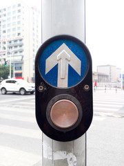 Crosswalk pedestrian signal button and sign to switch traffic
