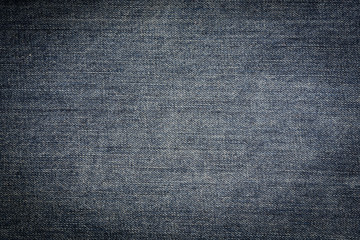 Textured vintage background - dirty blue jeans textile in close-up (high details)