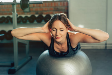 Fit young woman practicing pilates