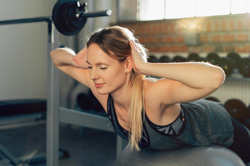 Young woman working out doing Pilates