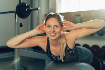 Smiling active fit young woman working out