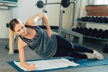 Beautiful woman exercising forearm side plank