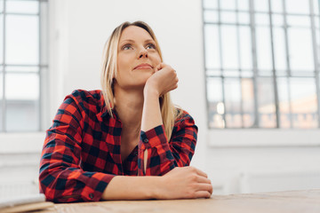 Attractive woman sitting reminiscing