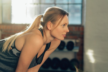 Attractive blond woman working out in a gym