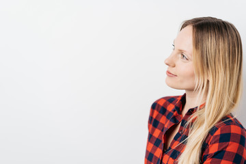 Thoughtful attractive woman looking at copy space