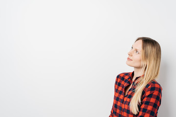 Attractive blond woman looking at blank copy space