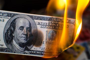 Burning one hundred dollar