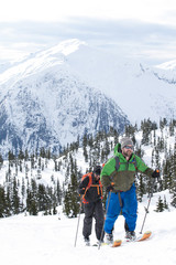 Young men ski touring in the mountains