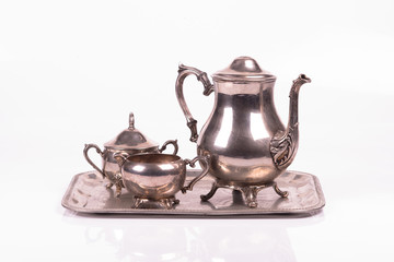 art deco silver sugar bowl and teapot on a tray