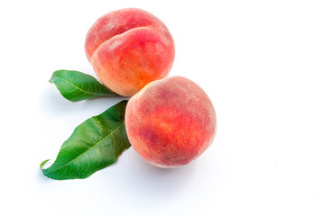 Fresh ripe juicy peaches on white background.