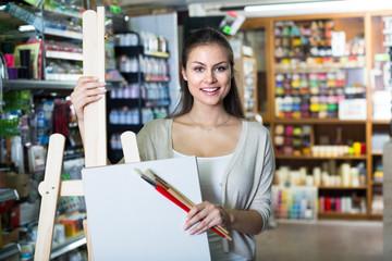 woman shopping wooden easel