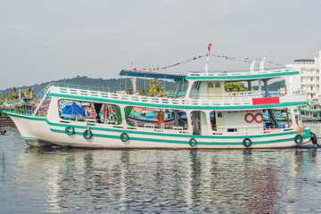 A group of colourful boats moored at Phu Quoc Vietnam. Boats such as these are iconic of the seaside port