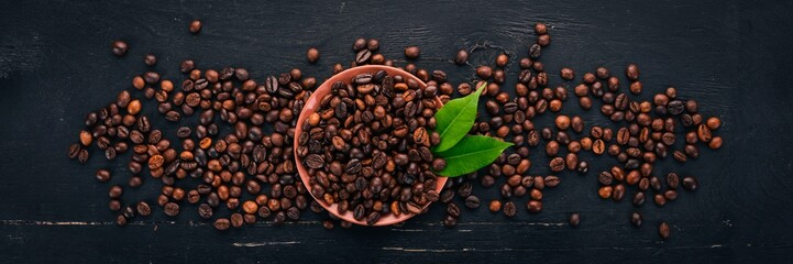 Canvas Prints Cafe Coffee beans. On a wooden background. Top view. Copy space.