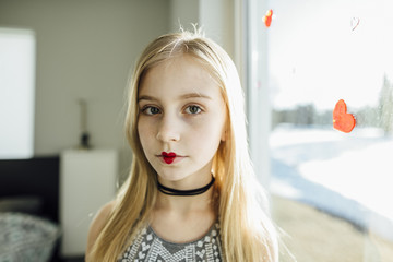 Portrait of girl with heart shape lipstick