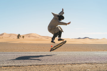Side view of man jumping while skateboarding on road against sky