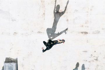 Overhead view of man skateboarding on footpath