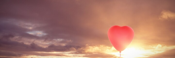 Composite image of valentines day pink heart balloon