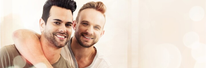 Smiling gay couple hugging