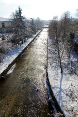 A panoramic view of Elassona's river in the snow. Elassona town, Thessaly region, central Greece.