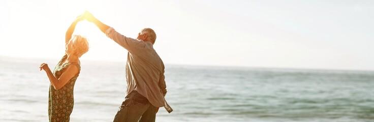 Senior couple dancing at beach