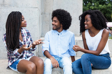 African american hipster man flirting with two woman