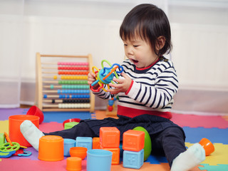 baby girl play toy at home