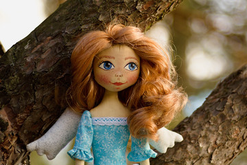 Hand made stitch doll angel in nature.
