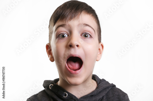 studio portrait cute boy screaming at the camera stock photo and