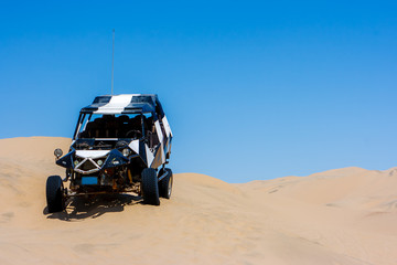 Dune buggy over a sand dune in the desert, Huacachina, Ica, Peru