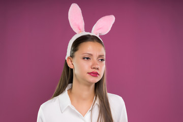 Sad dissatisfied woman Easter bunny, artificial ears