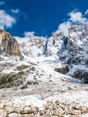 Rocky, majestic mountain range in winter, vertical image