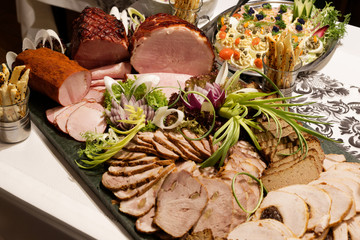 Cold cuts and salads on the table.