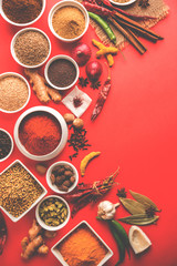 Raw Indian Spice Powder over red , green or yellow background, selective focus
