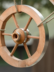 A wooden wheel hangs out as a decoration