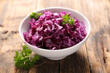 cabbage salad on wood background