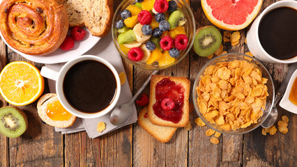 breakfast with coffee,croissant,fruit