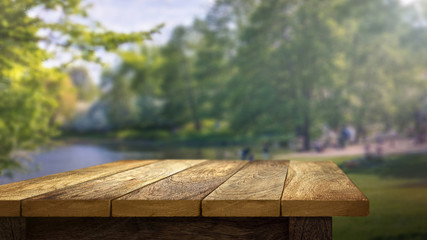 Wooden Table outside in park background