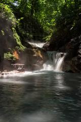 Hot water of the Oyunumagawa river flowing from the Oyunuma pond through Hell Valley (Jigokudani), Noboribetsu, Hokkaido, Japan