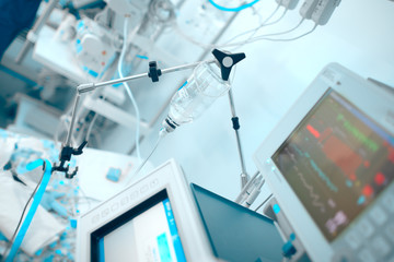 Life support devices connected to the critical condition patient in the ICU