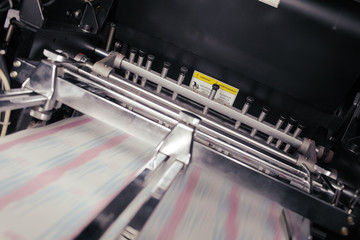 Blurred paper in motion during printing process