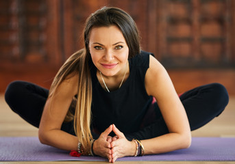 Young woman yoga trainer