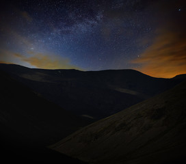Night starry sky. View of the Milky Way in a mountain valley.