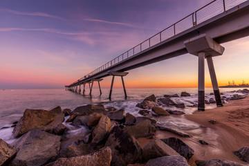 View of bridge over Mediterranean sea at sunset