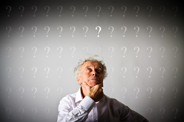 Old man in white and question marks.