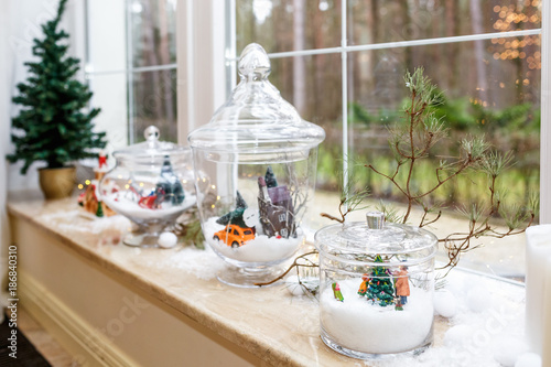 new years and christmas decorations on the windowsill of a panoramic loft window candles