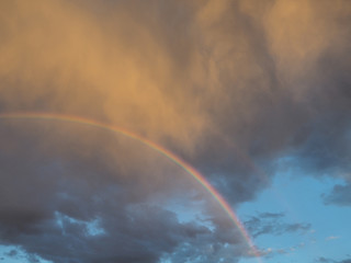 A Semicircle Of Different Colors Bright Rainbow In Gray Cloudy Sky Illuminated By