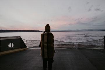 Woman standing on ship