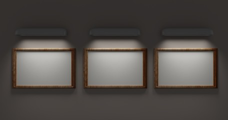 Three Picture frames. Lit by the lamp. Hang on the white wall. 3D rendering