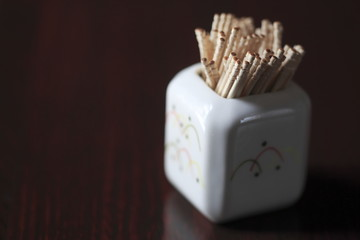 A toothpick in a container