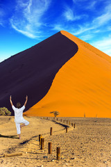 Woman practicing yoga in the desert